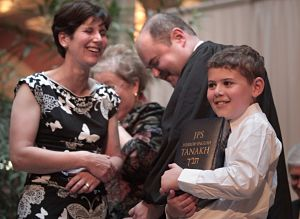 David Stras, with his wife and son, shortly after Stras was sworn in. Stras' son is holding the Hebrew Bible on which his father took the oath.