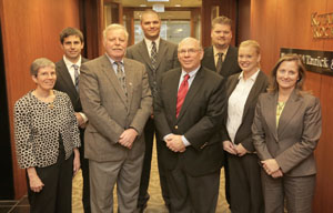 Some of the attorneys who are departing Mansfield Tanick for Hellmuth & Johnson, left to right: Teresa Ayling, Brian Christiansen, Marshall Tanick, Brian Niemczyk, Earl Cohen, Steve Rose, KrisAnn Norby-Jahner and Denise Tataryn. (Staff photo: Bill Klotz)