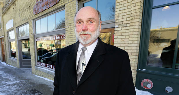 """Steve Holmgren, chief public defender for the 1st District,  stands near his office in downtown Chaska. He said he received 160 applications for two attorney openings. Being a public defender can be """"a fairly thankless job,"""" he says. """"You could have as many as 100 open files at once. You need to be a self-motivator who can trudge on."""" (Staff photo: Bill Klotz)"""