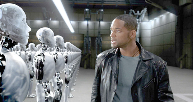 """On the hunt for a murderer, Will Smith, playing Chicago Police Detective Del Spooner, takes a close look at one of several thousand suspects, in """"I,Robot."""" (AP Photo: Digital Domain)"""