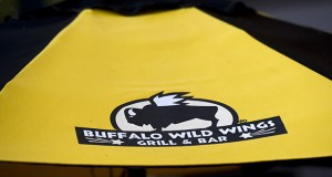 The Buffalo Wild Wings logo is displayed on an umbrella of a restaurant in Dublin, Calif., on Jan. 25. The restaurant company was at the center of a key trademark case, Buffalo Wild Wings International v. Grand Canyon Equity Partners, which challenged the use of its logo by former franchisees. (Bloomberg photo: David Paul Morris)