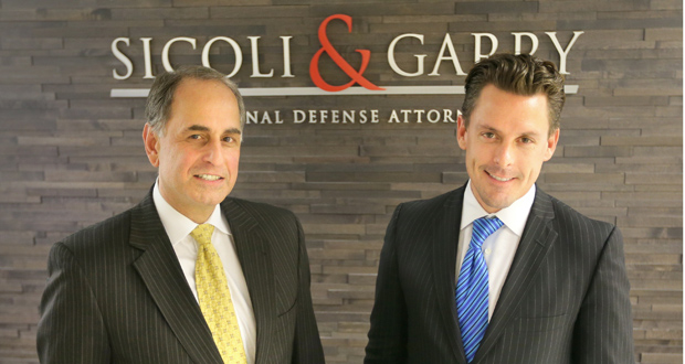 """Attorneys Robert Sicoli and Ryan Garry met in the downtown Minneapolis skyways and started talking about a partnership. They opened their firm this month. """"If you hire us, you get both us,"""" Sicoli said. (Staff photo:Bill Klotz)"""