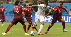 United States' Clint Dempsey, second from right, tries to push through Portugal's Ricardo Costa, right, and Portugal's Bruno Alves, left, June 22. (AP Photo)