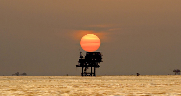 An offshore oil platform and wells are silhouetted by the setting sun in the Gulf of Mexico off the coast of Louisiana July 15, 2010, nearly three months after the BP Plc Deepwater Horizon oil spill. (File photo: BP Plc via Bloomberg)