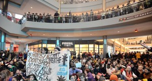 """Demonstrators fill the Mall of America rotunda on Saturday, Dec. 20, 2014, and chant """"Black lives matter"""" to protest police brutality. (AP photo: Star Tribune, Aaron Lavinsky)"""