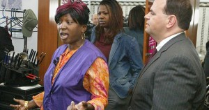 Institute for Justice Executive Director Lee McGrath represented Lillian Anderson (in purple and orange) and her African hair braiding service in south Minneapolis. The Board of Barber and Cosmetologist Examiners agreed to amend its rules to free hair braiders from a requirement to complete 1,550 hours of cosmetology training that can cost up to $14,500 in tuition. (File photo: Bill Klotz)