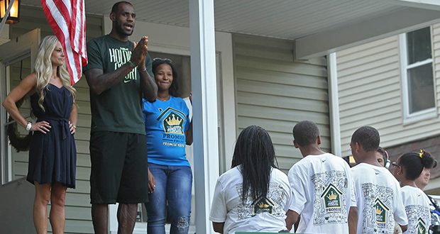 """""""Rehab Addict"""" TV show host Nicole Curtis, left, appears in 2014 with Cleveland Cavalier LeBron James and his wife, Savannah, at a renovation project in Akron, Ohio. The Minnesota Court of Appeals has ruled that a judge was right to toss out a defamation lawsuit brought by Curtis against her former boyfriend Jason Jenny. (AP file photo: Akron Beacon Journal)"""