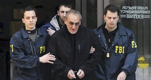 FBI agents escort reputed mobster Vincent Asaro, center, from FBI offices in New York's lower Manhattan on Jan. 23, 2014. AP file photo: Newsday