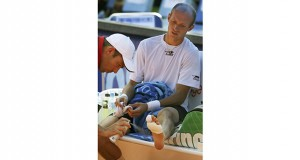 Nikolay Davydenko receives treatment on his foot during his match with Martin Vassallo Arguello on Aug. 2, 2007, at the Prokom Open in Sopot, Poland. Davydenko was handily dominating Arguello until Davydenko began missing shots, complaining of pain, and took a medical forfeit of the match. Ultimately, both Davydenko and Arguello were absolved of any match-fixing by the Association of Tennis Professionals. AP file photo