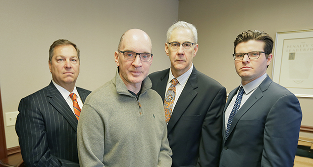 Mark Kedrowski, front, was severely injured in a plane crash in 2010. He and his legal team, from left, Cortney LeNeave, Stephen Watters and Thomas Fuller, procured a $27.7 million verdict from a Ramsey County jury. Staff photo: Bill Klotz