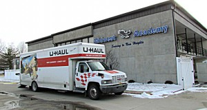 In this Feb. 11 photo, a U-Haul truck is parked outside the closed Midwest Academy in Keokuk, Iowa. Six former students have filed a lawsuit accusing the school of abusive practices. AP file photo: Daily Gate City, Cindy Iutzi
