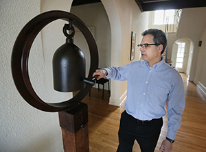 """Maslon partner Wayne Moskowitz rings a bell made from the shell of a bomb at the Minnesota Zen Meditation Center. """"I started meditating in the early 1990s,"""" said Moskowitz. Staff photo: Bill Klotz"""