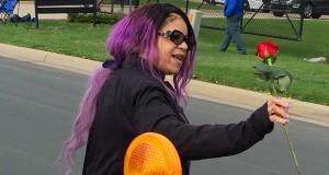Tyka Nelson holds a rose April 21 outside Paisley Park, the home of her brother Prince in Chanhassen. Nelson thanked fans who gathered at the home to mourn. A judge has granted Nelson's request to appoint a corporate trust company to temporarily oversee Prince's estate. (AP photo: Steve Karnowski)