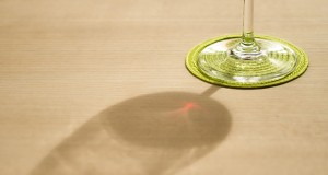 shadow of a glass with red wine