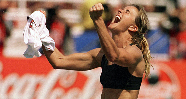 Brandi Chastain celebrates after kicking the game-winning penalty shootout goal against China in the 1999 FIFA Women's World Cup Final at the Rose Bowl in Pasadena, California. (AP photo: Lacy Atkins, The San Francisco Examiner)
