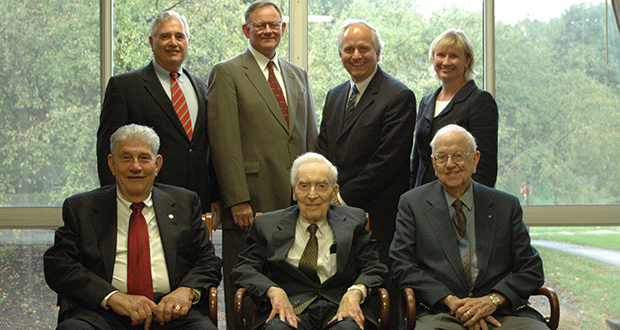 Former managing partners of Gray Plant Mooty in the early 2000s. Top row: Michael Sullivan Sr., Mike Cunningham, Bruce Mooty, Tamara Olsen. Front row: Russ Bennett, Frank Plant, John Mooty. (Submitted photo)