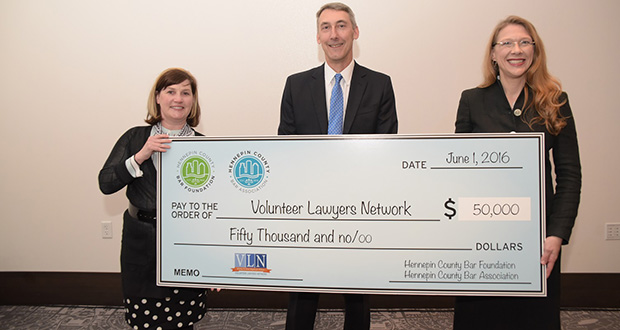 HCBA President Kim Lowe, left, and HCBF President Sharna Wahlgren presented Skip Durocher, the chair of the VLN Board of Directors, a check at the HCBA's annual meeting on June 1. (Submitted photo)