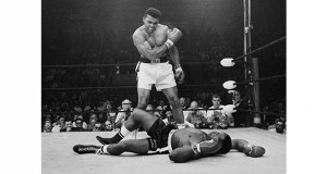 In this May 25, 1965 file photo, Heavyweight champion Muhammad Ali stands over fallen challenger Sonny Liston, shouting and gesturing shortly after dropping Liston with a short hard right to the jaw in Lewiston, Maine. Ali, the magnificent heavyweight champion whose fast fists and irrepressible personality transcended sports and captivated the world, has died according to a statement released by his family Friday, June 3, 2016. He was 74. (AP Photo/John Rooney)