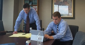 Men at work: Paul McEllistrem, left, and partner Andy Rorvig strategize after the third day of testimony in Gronholz v. AAA Labor. (Submitted photo)
