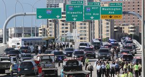 More than three dozen activists protesting the July 6 shooting of Philando Castile blocked southbound Interstate 35W near University Avenue in Minneapolis on Wednesday morning before police arrested them and put them on a bus. In this photo, dozens of police and state patrol vehicles, buses and tow trucks fill southbound lanes of the 35W bridge. (Staff photo: Bill Klotz)