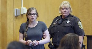 Morgan Geyser is led into the courtroom Aug. 19 in Waukesha, Wisconsin. Geyser, one of two girls accused of trying to kill a 12-year-old classmate two years ago, pleaded not guilty Friday by reason of mental disease or defect. (AP photo: Milwaukee Journal-Sentinel)