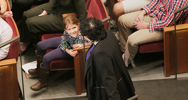"""U.S. Supreme Court Justice Sonia Sotomayor pauses near a young girl in the Northrop Auditorium audience Aug. 17, and directs remarks to her. With the 1981 appointment of Justice Sandra Day O'Connor, she said, """"I could aspire [to become a judge]. Doors had to open."""" (Staff photo: Bill Klotz)"""