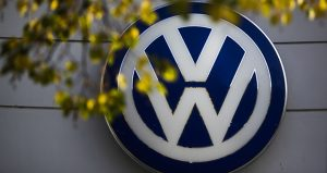 The VW sign of Germany's Volkswagen car company is displayed at the building of a company's retailer in Berlin. (AP file photo)