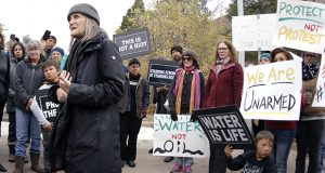 """Journalist Amy Goodman, left, speaks with supporters in Mandan, North Dakota, before learning the rioting charge filed against her was dismissed by a district judge Oct. 17. The """"Democracy Now!"""" reporter was covering the Dakota Access Pipeline protesters in September and was initially charged with trespassing. (AP photo: The Bismarck Tribune)"""