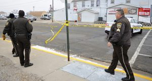 Investigators search the area near the scene where a Cold Spring police officer Tom Decker was fatally shot Nov. 29, 2012. (AP photo: The St. Cloud Times)