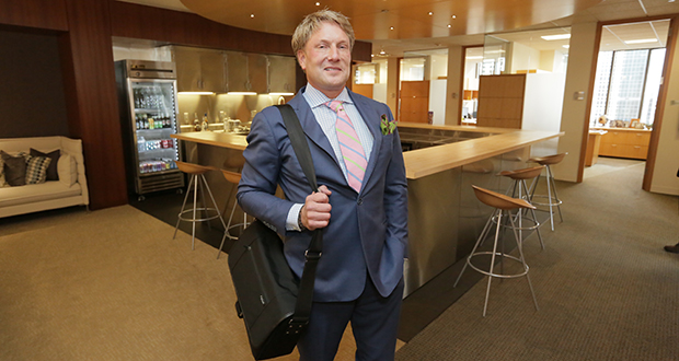 Clayton Halunen stands proudly with his Martin Patrick briefcase draped magisterially over his right shoulder. (Staff photo: Bill Klotz)