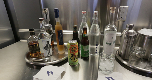 The lounge at Halunen Law features a fully-stocked bar with lots of local brand-name appeal: Tattersall vodka, J. Carver bourbon and rye, Du Nord Fitzgerald gin, Alexis Bailey ice wine. (Staff photo: Bill Klotz)