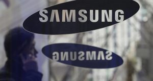 A man passes the Samsung Electronics Co. logos at its headquarters in Seoul, South Korea. The U.S. Supreme Court has sided with Samsung in its high-profile patent dispute with Apple over design of the iPhone. (AP file photo)