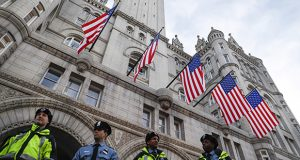 Police stand guard Jan. 19 outside the Trump International Hotel on Pennsylvania Avenue in Washington. While President Donald Trump's hotel in Washington did serve as a hub of inaugural activities it also stands as ground zero for what top Democrats and some ethics advisers see as his unique web of conflicts of interest. (AP photo)