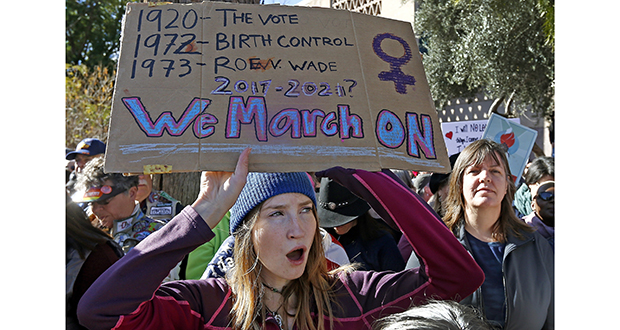 Demonstrators listen to speakers in support of the Women's March on Washington at the Arizona Capitol on Saturday, Jan. 21, in Phoenix. (AP photo)