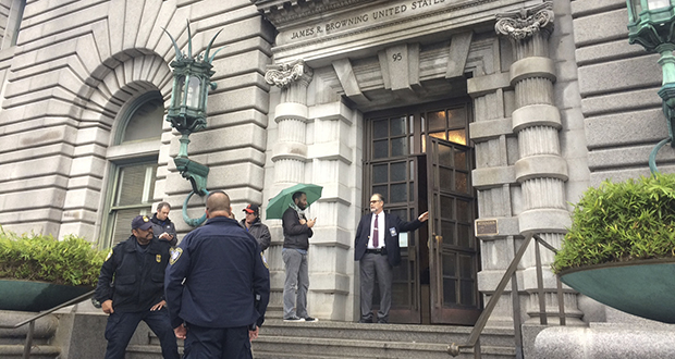 Security officers are seen outside the 9th U.S. Circuit Court of Appeals building in San Francisco on Thursday, Feb. 9, 2017. A federal appeals court refused Thursday to reinstate President Donald Trump's ban on travelers from seven predominantly Muslim nations, dealing another legal setback to the new administration's immigration policy. (AP Photo/Haven Daley)