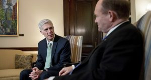 Supreme Court Justice nominee Neil Gorsuch, left, meets with Sen. Chris Coons, D-Del. on Capitol Hill. (AP Photo/Andrew Harnik)