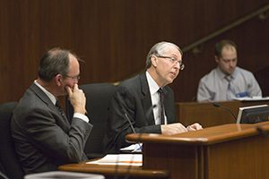 """Insurance Federation of Minnesota President Bob Johnson testifies before the House Civll Law and Data Practices Policy Committee in favor of a bill to protect landowners from owing a """"duty of care"""" to trespassers. The bill, authored by Rep. Dan Fabian, R-Roseau (left), passed 9-6 on a straight party-line vote on Feb. 14 It now heads to the House floor. (Staff photo: Kevin Featherly )"""
