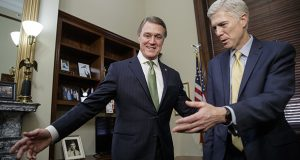 Supreme Court Justice nominee Neil Gorsuch, right, meets with Sen. David Perdue, R-Georgia, on Feb. 10 on Capitol Hill in Washington. (AP photo: J. Scott Applewhite)
