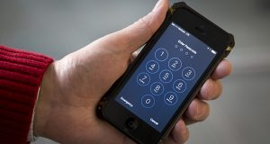 The Associated Press and other news organizations are asking a judge to force the federal government to reveal how much it paid for a tool to unlock an iPhone used by one of the San Bernardino shooters. (AP file photo)