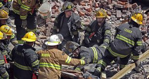 Philadelphia firefighters search the rubble of a collapsed building June 5, 2013. A building that was being torn down collapsed with a thunderous boom, raining bricks on a neighboring thrift store, killing six people and injuring at least 13 others. (AP file photo)