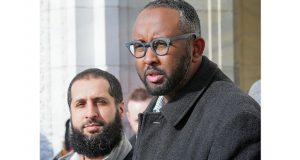 """Jaylani Hussein, right, executive director for the Minnesota chapter of the Council on American-Islamic Relations, said that """"countless horror stories"""" have been shared with his organization. At left is Amir Malik, the organizations civil rights director. (Staff photo: Bill Klotz)"""