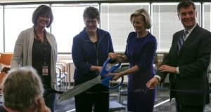 Cutting the ribbon in Hennepin County's new jury assembly room (left to right): 4th Judicial District Administrator Kate Fogarty, Hennepin County Commissioner Jan Callison, 4th District Chief Judge Ivy Bernhardson and Hennepin County Administrator David Hough. (Photo courtesy of Hennepin County)