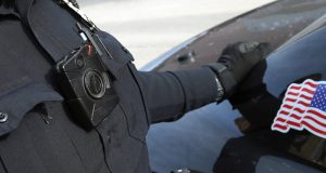 In this Feb. 2, 2015, file photo, Duluth police officer Dan Merseth has his body camera activated. Some judges are demanding written transcripts of all body-cam footage before it is introduced into evidence. (AP file photo: Jim Mone)