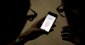 By pressing your finger to your iPhone, immediate access to your stored data is granted. In this sense, a fingerprint alone may have the power to reveal an abundance of personal information. (AP file photo)