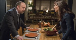 """In this image released by Showtime, Paul Giamatti portrays Chuck Rhoades, left, and Maggie Siff portrays Wendy Rhoades in a scene from the series, """"Billions."""" (AP photo: Jeff Neumann, Showtime)"""