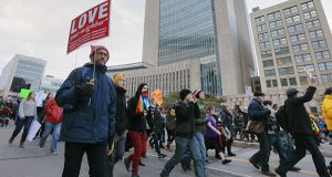 Protesters march past the U.S. Courthouse in Minneapolis on Tuesday to protest President Donald Trump's temporary immigration ban on seven predominantly Muslim countries. Lawyers have assumed a central role in the unfolding drama, offering assistance to people affected by the ban. (Staff photo: Bill Kotz)