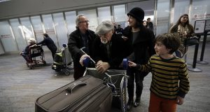 In this Jan. 28 photo, Abdollah Mostafavi, center, arriving from Tehran, Iran, is met by his family at San Francisco International Airport in San Francisco. Mostafavi was held at the airport for some time as a result of President Donald Trump's executive order. (AP file photo)