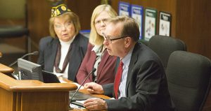 Veterans court pioneer and Washington County Attorney Pete Orput (right) appears before the Veterans Affairs Division Committee on Feb. 13 in support of House File 728. Also pictured (center) is bill author Rep. Debra Hillstrom, DFL-Brooklyn Center, and (left) Peggy Moon, the American Legion's Minnesota legislative director. (Staff photo: Kevin Featherly)