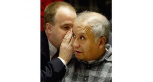 Alfonso Rodriguez Jr. listens as his attorney, David Dusek, whispers to him during a preliminary hearing in District Court on March 5, 2004, in Grand Forks, North Dakota. (AP file photo)