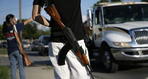 The Second Amendment to the U.S. Constitution and Minnesota law do not convey a right to carry a loaded AK-47 rifle in public, according to a ruling by U.S. District Court Chief Judge John Tunheim. In this photo, a gun-rights advocate in Haltom City, Texas, carries an AK-47 over his shoulder in 2014. (AP file photo)